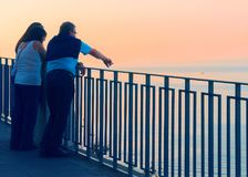 People looking at sunset in Marina Grande in Sorrento. People looking at the sunset on the embankment in Marina Grande in Sorrento, Tyrrhenian sea, Amalfi coast royalty free stock photography
