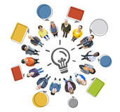 People Looking Up with Light Bulb Symbol and Speech Bubbles stock image