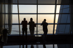 People looking on view from observation deck Stock Images