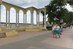 People with a lot of weight walk along the Gorky embankment in the resort town