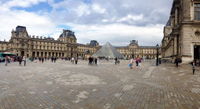 People and the Louvre. Paris,France-July 8th 2014: people walking in front of the Louvre pyramid. The Louvre Museum is one of the world's largest museums Royalty Free Stock Photo