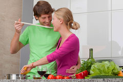 People in love making spaghetti. Young people in love cooking italian dinner Stock Photos