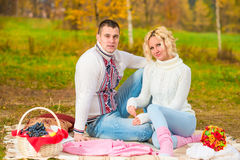 People loving to spend time at a picnic Stock Images