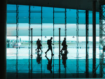 People with luggage walking at airport Royalty Free Stock Images