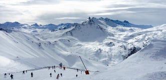 People Lurking Around on Snow Field Near Mountains Royalty Free Stock Photos