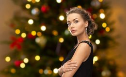 Beautiful woman with diamond jewelry on christmas royalty free stock photography