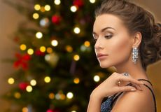 Beautiful woman with diamond jewelry on christmas royalty free stock images