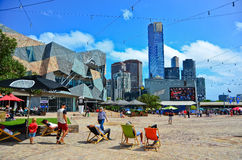 People lying on the deckchair at the Federation Square in Melbourne Royalty Free Stock Photos