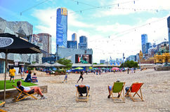 People lying on the deckchair at the Federation Square in Melbourne Royalty Free Stock Photo