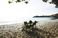 People Lying On Green Wooden Lounger Chairs On Beach Royalty Free Stock Images