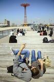 People lying in the sun Stock Image
