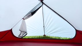 People lying in tent with a view stock photos