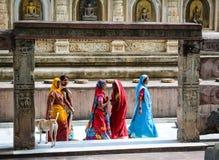 People at Mahabodhi Temple in Gaya, India. Bodh Gaya, India - Jul 9, 2015. Indian women walking at Mahabodhi Temple Complex in Bodhgaya, India. The Mahabodhi Stock Photo