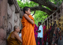 People at Mahabodhi Temple in Gaya, India. Bodh Gaya, India - Jul 9, 2015. People praying at Mahabodhi Temple Complex in Bodhgaya, India. The Mahabodhi Vihar, a Stock Photo