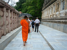 People at Mahabodhi Temple in Gaya, India. People walking at Mahabodhi Temple Complex in Bodhgaya, India. The Mahabodhi Vihar, a UNESCO World Heritage Site, is a Stock Photography