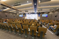 People in main conference hall stock image