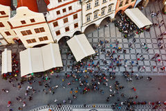 People on the main Prague square awaiting for the clock event. Prague cityscape with medieval buildings and crowd on the Old Square royalty free stock photos