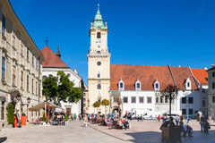 People at Main Square in Bratislava city. BRATISLAVA, SLOVAKIA - SEPTEMBER 22, 2015: people at Main Square (Hlavne namestie) and view of old Town Hall in Stock Images