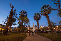 People on Main Square and Cathedral at dusk, Arequipa, Peru Stock Images