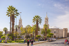 People on Main Square and Cathedral at dusk, Arequipa, Peru Stock Photos