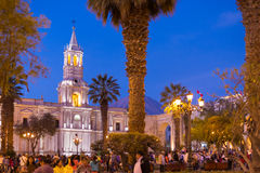 People on Main Square and Cathedral at dusk, Arequipa, Peru Royalty Free Stock Photography