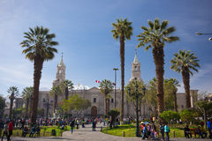 People on Main Square and Cathedral at dusk, Arequipa, Peru Royalty Free Stock Photos