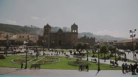 People on the main square.Square with church, Cuzco,Peru.