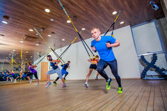 People make fitnes exercise with a band in the gym Stock Images