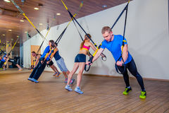 People make fitnes exercise with a band in the gym Royalty Free Stock Image