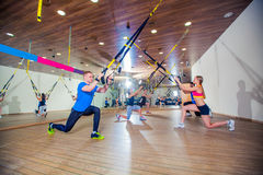 People make fitnes exercise with a band in the gym Stock Photography