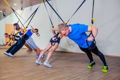 People make fitnes exercise with a band in the gym Stock Photo