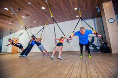 People make fitnes exercise with a band in the gym Stock Image