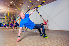 People make fitnes exercise with a band in the gym Royalty Free Stock Photography
