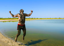 People make mud therapy and are very happy. People are doing mud therapy Stock Images