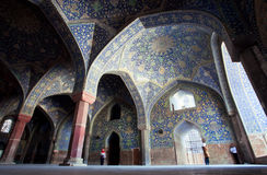 People make photos under the arches of old persian Imam Mosque in Iran Royalty Free Stock Photo