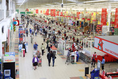 People make purchases in Auchan superstore Stock Photos