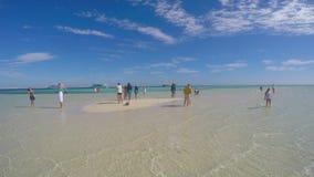 People make selfie when walking on a sandy island stock video