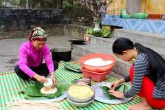 People make square glutinous rice cake Stock Image