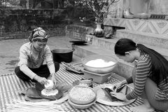People make square glutinous rice cake Royalty Free Stock Photo