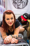 People make a tattoos at the 10-th International Tattoo Convention in the Congress-EXPO Center. Stock Photo