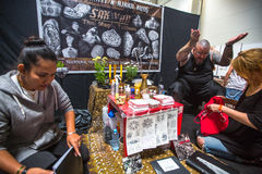 People make a tattoos at the 10-th International Tattoo Convention in the Congress-EXPO Center. Stock Photography