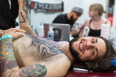 People make a tattoos at the 10-th International Tattoo Convention in the Congress-EXPO Center. Royalty Free Stock Photos