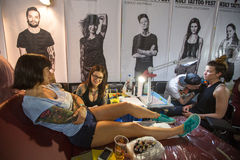 People make a tattoos at the 10-th International Tattoo Convention in the Congress-EXPO Center. Stock Image