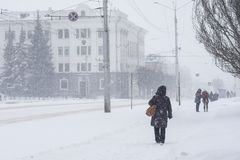 People make their way through heavy snow, poor visibility. Snow storm in the city of Cheboksary, Chuvash Republic, Russia. 01/17/2. 016 Royalty Free Stock Photo