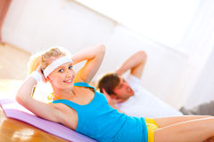 People making abdominal crunch in gym Stock Image