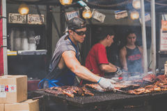 People making barbecue Stock Photo