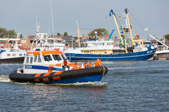 People making boat trip at lifeboat demonstration in Dutch harbor Stock Photography