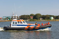 People making boat trip at lifeboat demonstration in Dutch harbor Royalty Free Stock Photography