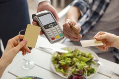 People making a card payment by terminal Stock Photography