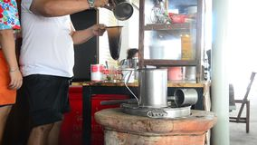 People making hot coffee thai style stock footage